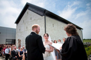 bride and groom getting married outside of museum