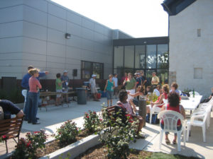 celebration outside of museum space with tables and chairs
