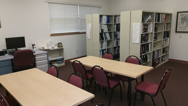 Old Research Center with tables and bookshelves.