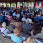 Audience attending an outdoor mass.