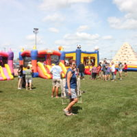People playing at bounce-castles