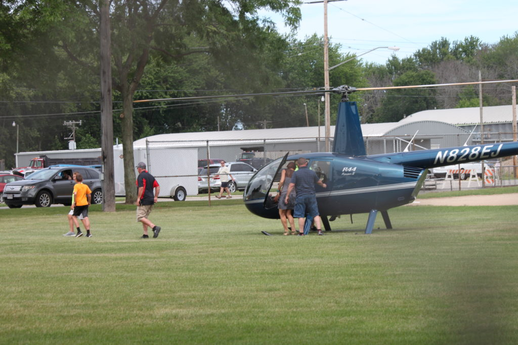A helicopter in a field.
