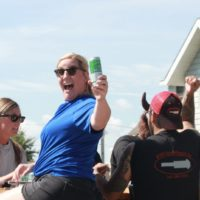 Woman holding up a Bofferding Beer.