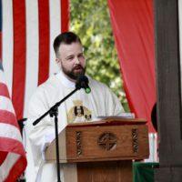 Priest speaking at Polka Mass