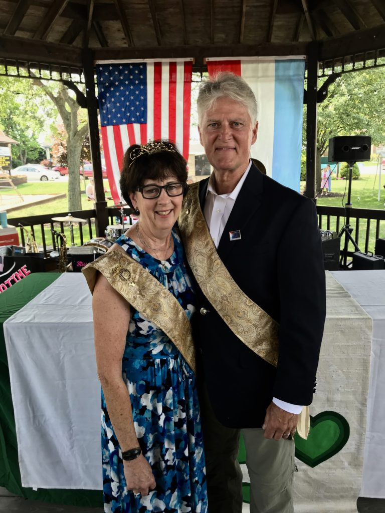 King and Queen of Lux Fest, wearing gold sashes.