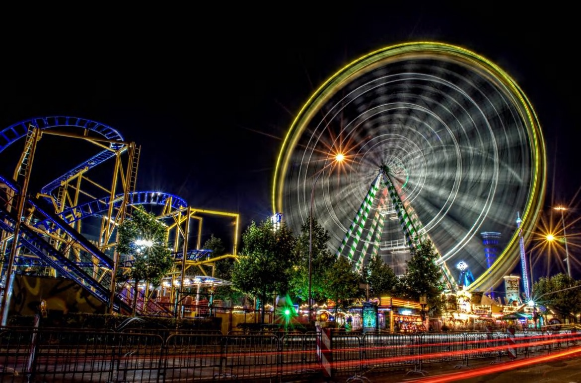 Nightime photo of an outdoor event with a ferris wheel.